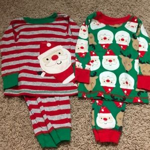 Two pairs of 12 month Christmas pajama sets